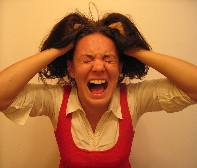 Woman pulling her hair out